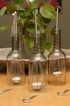 Upcycled Wine Bottle Luminary - These actually hide the fact that they're bottles. Inspiration only. (Cut bottom of bottle off, use wire whisk to hold votive cup)