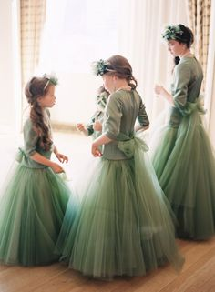 Flower girls dressed in beautiful green tulle and pearls