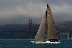 Rosebud's owner Roger Sturgeon sails to weather on San Francisco Bay, with the North towner of the Golden Gate Bridge in the background during the 2007 Rolex Big Boat Series hosted by the St. San Francisco Bay, Sail Away, The St, Golden Gate Bridge, Animals Beautiful, Sailing, Big, Places, Sailboats