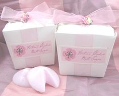 Fortune Cookie Soap Wedding Favor Set comes with two guest soaps packaged in a white take out box. Each soap is light pink in color with a wonderful rose scent. The box is decorated with with a pink organza ribbon, a pink flower accent, and a cherry blossom label that can be personalized.
