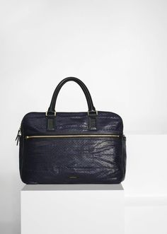 Men's navy leather 'Rafferty' flight bag with a perforated star pattern
