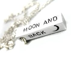 "Hand Stamped Aluminum Bar Pendant - Love You to the Moon and Back Necklace. Nifty Hand Stamped aluminum bar pendant. This 1"" long aluminum bar pendant has been hand stamped with 'Love you to the moon and back'. The pendant comes on a silver plated cable style chain (chain is approximately 18"" - 22"" long). Handcrafted in the U.S. by Foxwise. Quick shipping from California, US seller, ships in a gift box or bag."