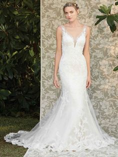 Casablanca 2286 Ivy features perfecting satin fit and flare sheath under a lace appliqued overlay, with an illusion V-neckline and thick straps that flow into an illusion ...