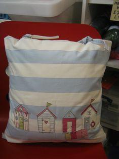 Beach hut themed tie cushion