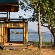 Lakeside retreat in Sri Lanka made using a stray shipping container and timber from weapon boxes.