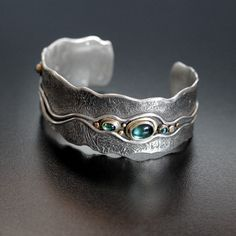 Jewelry | Jewellery | ジュエリー | Bijoux | Gioielli | Joyas | Art | Arte | Création Artistique | Artisan | Precious Metals | Jewels | Settings | Textures | Big Silver River Cuff Bracelet (Silver, 18ct Gold + 5 Aqua/Teal Tourmalines) By Abi Cochran