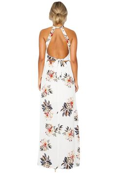 The Floral Cutout Back Halter Split Maxi Boho Dress has an on trend high neckline contrasted with a low, cut away back. With cross-back straps and a tie up feat