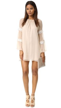591416938d90 Scalloped lace panels accent the long sleeves of this airy Amanda Uprichard  shift dress. Hook
