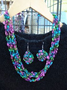 Trellis yarn necklace and earrings.  I'm selling necklaces (like this one) at Boardwalk Antiques in Walker, LA and will be making some matching earrings soon.  Email me at beadcellar@cox.net.