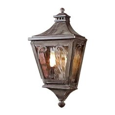"Camden 2 Light 20 Inch Tall Outdoor Wall Sconce by ELK Lighting. $398.00. Finish: Charcoal,Glass: Water. UL Listing: Wet Locations. Lamping: 2 - Candelabra Base 60 Watt, Lamp Type: Incandescent. Height 20 Inch,Width 10 Inch,Extension 7 Inch. Connection: Hardwire. Elk Lighting 5715-C Camden 2 Light 20 Inch Tall Outdoor Wall SconceDecorative and stylish, the Camden solid brass 20"" tall outdoor wall sconce installs flush against the wall and features elegant finials, a gently slo..."