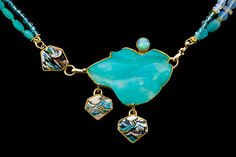 """MARIANNE HUNTER """"The seas sing""""     their own songs~ the seasons shift the song goes on   Stones and Materials  MATERIALS: Enamel w/Foils Steve Walter's Carved Chrysacola in Quartz Opal  METALS: 24K • 14K • Platinum-Silver, Fabricated & Engraved  BEADS:  Peruvian Opal, Apatite, Opal, 20kt  Size:  2 1/8""""h x 2 7/8""""w x 5/16""""d"""
