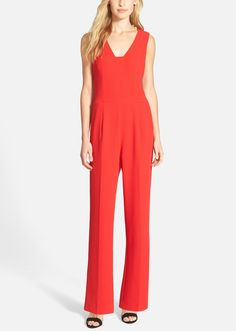 The minimalist silhouette of this red-hot jumpsuit makes street-chic style dressing so simple. Pair with a clutch and black strappy sandals and voilà!