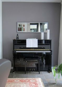 Mirror above piano