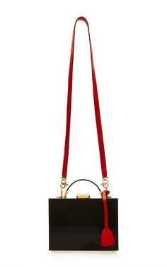 cf121684d35f This handbag by   Mark Cross   features a new take on the trunk style that  first gained fame and exposure as Grace Kelly s namesake accessory of  choice.