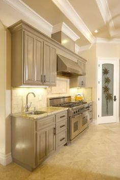 Love the light gray cabinets with lighter granite countertops! #magnoliahomes
