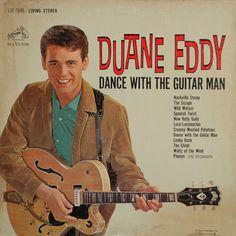 Duane Eddy – Dance With The Guitar Man  http://www.discogs.com/Duane-Eddy-Dance-With-The-Guitar-Man/release/2164475    http://en.wikipedia.org/wiki/Duane_Eddy