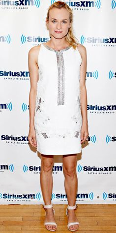 Kruger swung by SiruisXM Studios in a silver-accented Vanessa Bruno shift and sleek sandals.