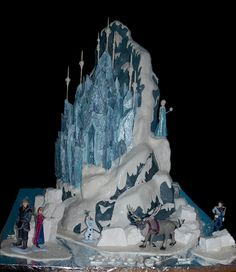 Mountain was all cake; castle was part cake, part RKT; figurines were purchased from the Disney Store (.com); used some homemade marshmallows for the icebergs at the base.