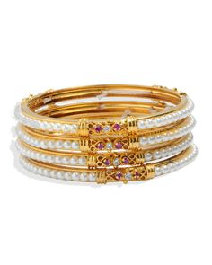 """<p style=""""text-align: justify;"""">Check out this bangles from AGG that will be an ideal pick for the stylish Indian woman of today. Featuring an attractive design, these bangles will blend well with both suits and sarees. These bangles are light in weight and skin friendly as well.</p>"""