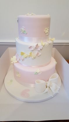 3 tier pretty birthday cake with butterflies and bow