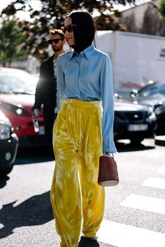 Paris Fashion Week Street Style: Color blocked high-rise trousers and minibag
