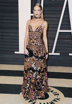 Poppy Delevingne wearing a multi-colored floor length gown the 2015 Vanity Fair Oscar After-Party