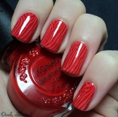 red faux bois manicure - never used a stamping kit, but stuff like this makes me want to try it