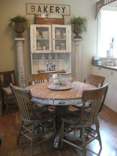 Farmhouse Dining...old round table & chairs...love the chippy pillar and the cupboard! - MyHomeLookBook