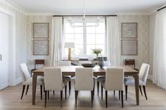 Clean lines and exceptional materials are exhibited in the home's dining room, where refined tufted dining chairs by Baker line up uniformly beneath a walnut Holly Hunt table | archdigest.com