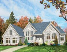 Lovely designed windows adorn this 3 bedroom Cottage style home.  Cottage House Plan # 571091.