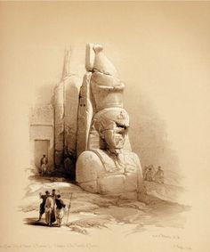A COLOSSAL STATUE AT THE ENTRANCE TO THE TEMPLE OF LUXOR.