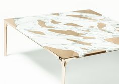 Marble was paired with bronze to create this unusual coffee table.