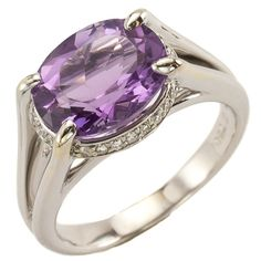 Amethyst Surprise: Light purple amethyst set longways on the hand is the highlight of this more modern white gold ring but if you look closely you'll notice a sparkling ring of pave set diamonds that encircle the amethyst from underneath! A fun surprise that adds a little twist to a classic style. Maloys.com