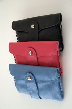 little purse in black, pink and blue, can be worn with wrist strap or regular strap or as a clutch, leather