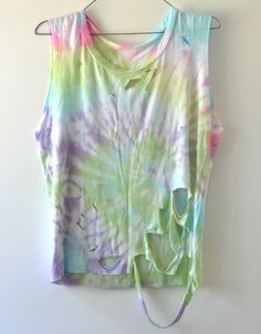 Soft tye dye top which has been distressed. Shell colours