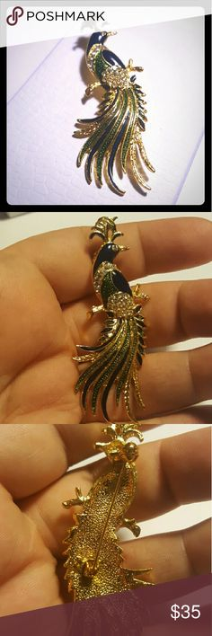 Fancy Vintage Enamel Peacock Brooch Beautiful Vintage Enamel Peacock Brooch. Sparkle blue and green enamel with goldtone edges and backing. Has diamond rhinestones as well. Excellent condition. Vintage Jewelry Brooches