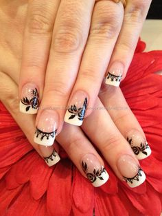 Black nail art design on French tip