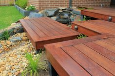 These Merbau decking pontoons with outdoor lighting system build platforms over a natural stone hand-made waterfall and pebble creek bed.  See the whole Bentleigh Project at www.intrinsiclandscapes.com.au