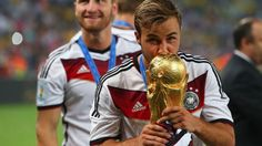 mario gotze with the world cup trophy. scored the winning goal in overtime.