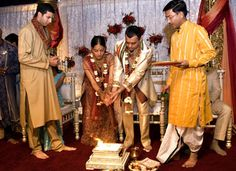 Vivah Havan  Reena and Himanshu offer rice into the sacred fire or Agni. Commitments made in the presence of Agni are made in the presence of God.