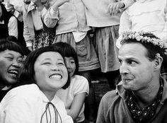 Marlon Brando making children laugh in Japan.