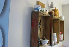 Soda Crate wall shelves - would be cute shadow boxes for small sports memorabilia, pictures.