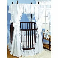 pretty! i love round cribs.