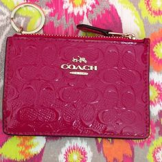 """Coach fuschia ID cardholder/keychain NWT Fuschia patent leather ID cardholder/keychain, zipper closure, one outside slot, silver tone hardware. Photo 3 truest color. Approx. measurements: 4.5x3"""". PRICE FIRM Coach Accessories Key & Card Holders"""