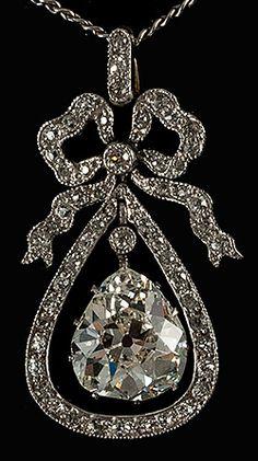 5699af9f9e4 Platinum set bow diamond pendant with old pear shaped diamond centre drop  high colour si stone