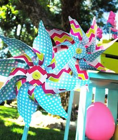 pinwheels...would be cute on a straw.  I also like the decoration and button in the middle.
