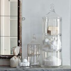stacked apothecary jars from west elm. build up your bathroom. stacking glass containers make a stylish space-saver and are a great way to display bath salts, soaps, sponges and more.