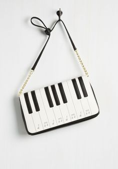 Octave Participant Bag. As soon as your radar picks up this quirky purse, you hop on the chance to get involved. #white #modcloth