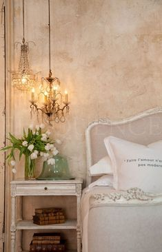 Shabby chic bedroom with chandeliers & tulips