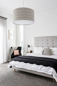 """In the master bedroom, the king-size bed and bedhead were custom-made pieces from [Dwell](http://www.dwell.com/ target=""""_blank""""). Using different shades of the same colour creates subtle contrast."""